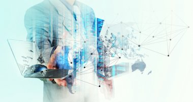 Double exposure of businessman shows modern technology as concep