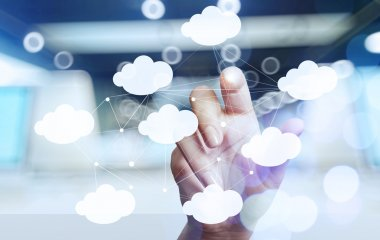 Businessman hand working with a Cloud Computing diagram on the n