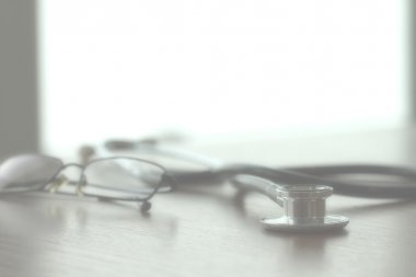 Studio macro of a stethoscope and glasses with shallow DOF evenl
