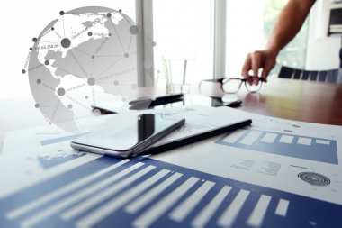 business documents on office table with digital tablet and man w