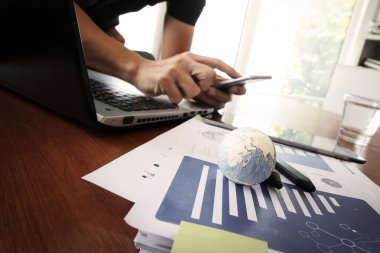 business documents on office table with texture the world on dig