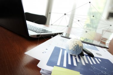 business documents on office table with texture the world on sma