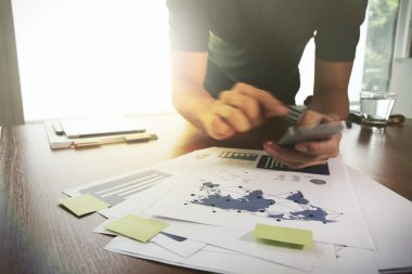 Young creative designer man working at office and smartphone as