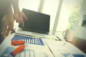 Fotografie business documents on office table with smart phone and digital