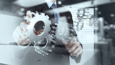 double exposure of businessman hand show human gear to success a