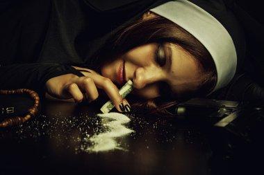 Pretty nun snorting cocain over dark background stock vector