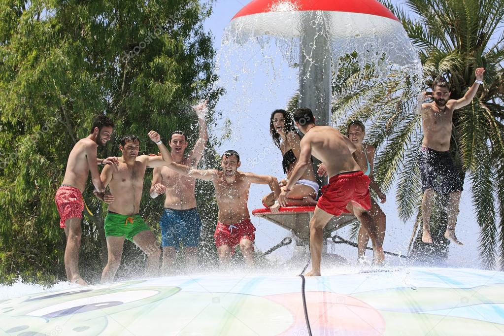 Cheerful group of young people in the  water park
