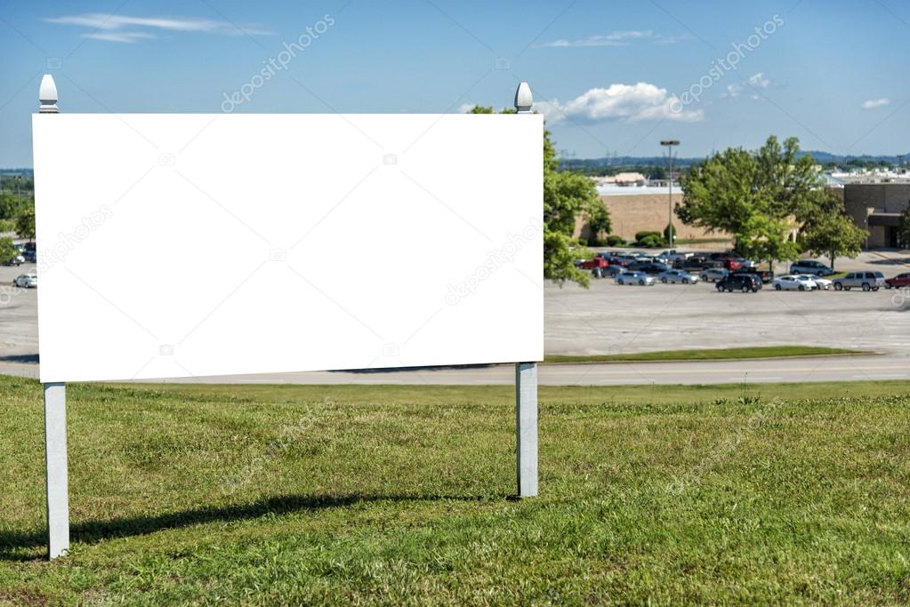 blank real estate sign in front of business stock photo