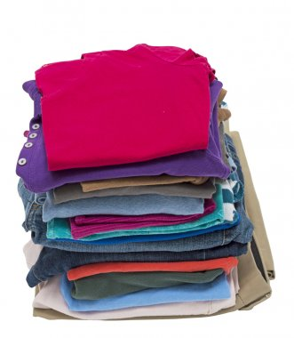 Tall Stack Of Folded Clothing Shot At Angle