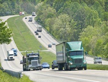 Trucks Climbing Hill On Highway