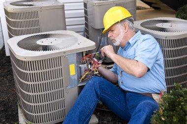 Air Conditioning Repairman At Work
