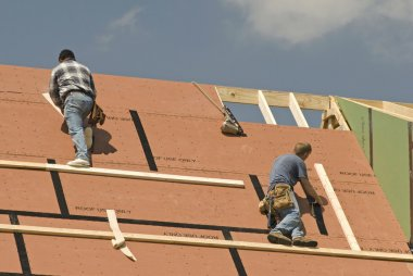 Roofers Constructing New Home