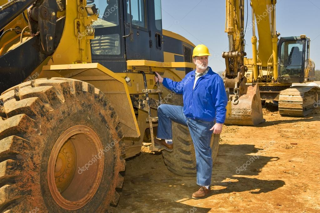 Highway Construction Worker With Heavy Equipment