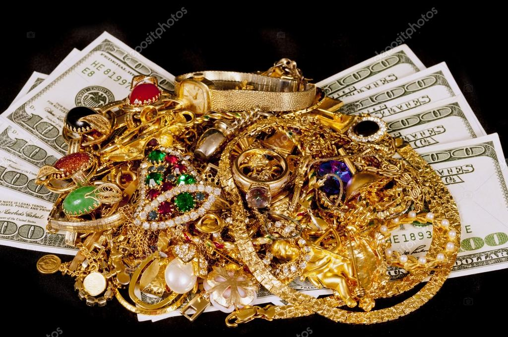 Gold Jewelry And Cash On Black Background Stock Photo