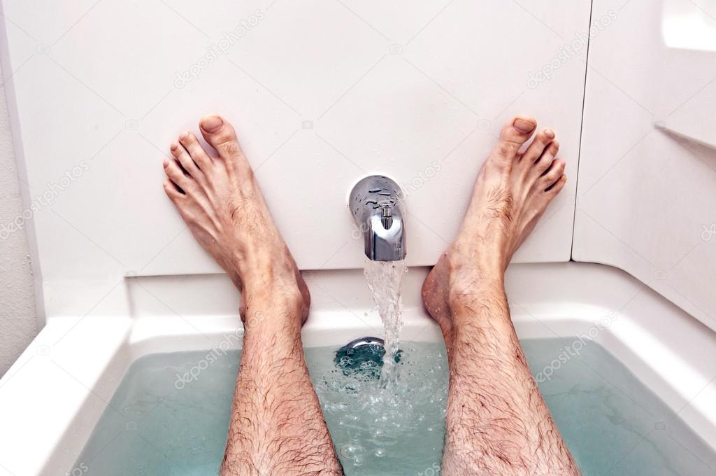 Man Resting In Tub With Feet Up and Water Running — Stock Photo ...