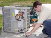 Photo Air Conditioning Repair Man Checking Freon Levels