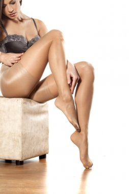 Woman in nylon stockings and bra