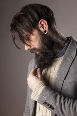 beard, tattoos and ear-piercing