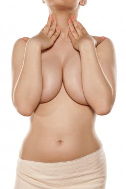 bare breasts covered by hands