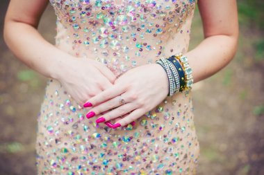 Female hands with a beautiful manicure and jewelry