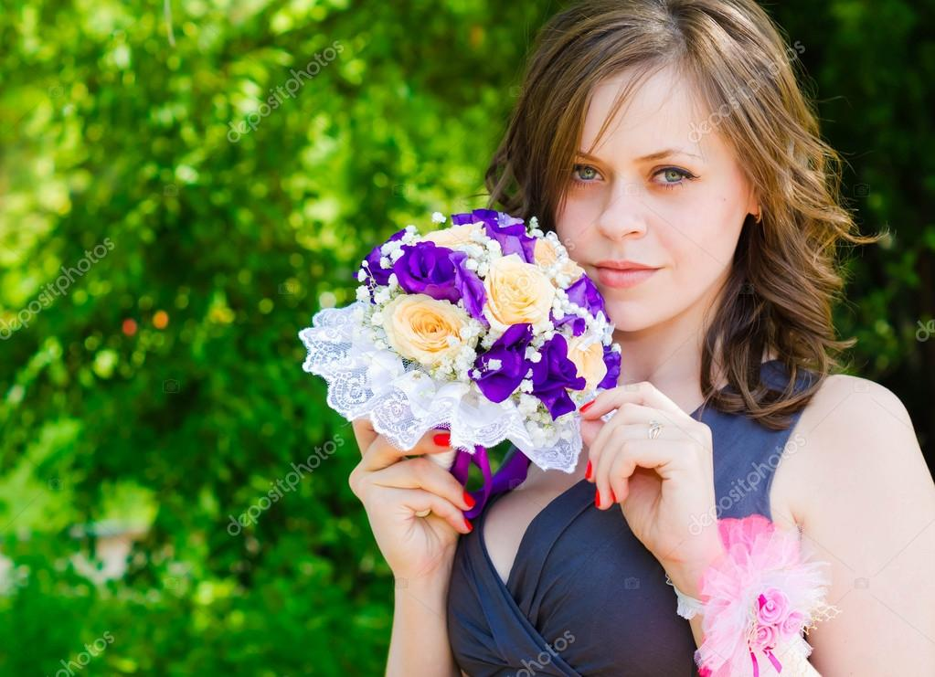 Lovely bridesmaid with flower bouquet