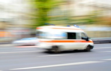 Ambulance in motion driving down the road
