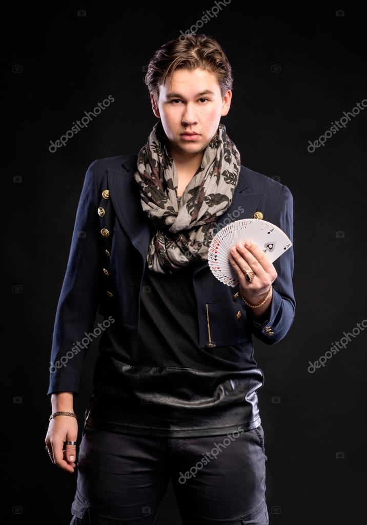 Young man with playing cards