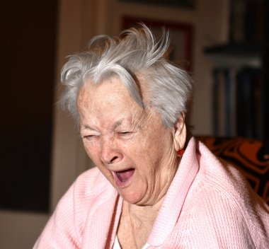 Old woman yawning