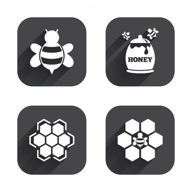 Honeycomb cells with bees symbols