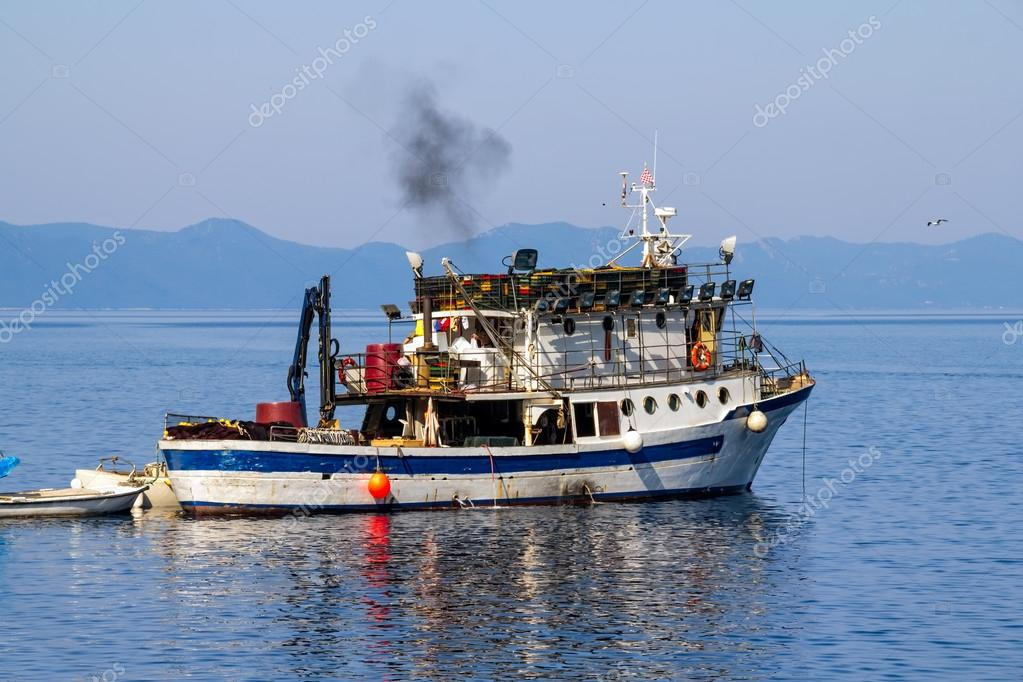 Fishing boat preparing for departure