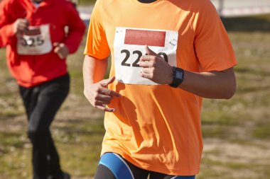 Male athletic runner on a cross country race. Outdoor circuit
