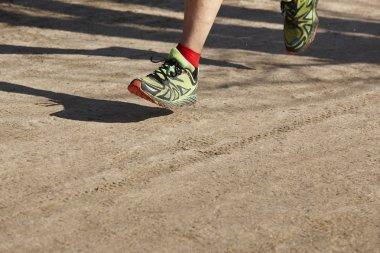 Senior athletic runner leg detail. Outdoor circuit. Sports