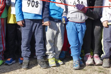 Children athletics runner on a cross country race. Start