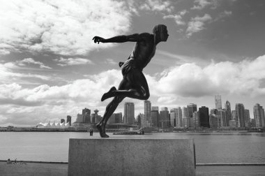 Stanley Park and Vancouver skyline. Harry Jerome sculpture. Cana