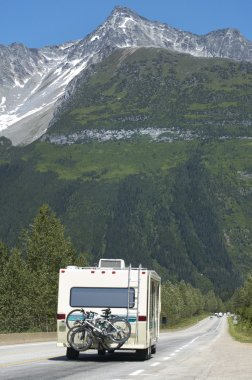 Canadian highway with motorhome and cars. British Columbia. Cana