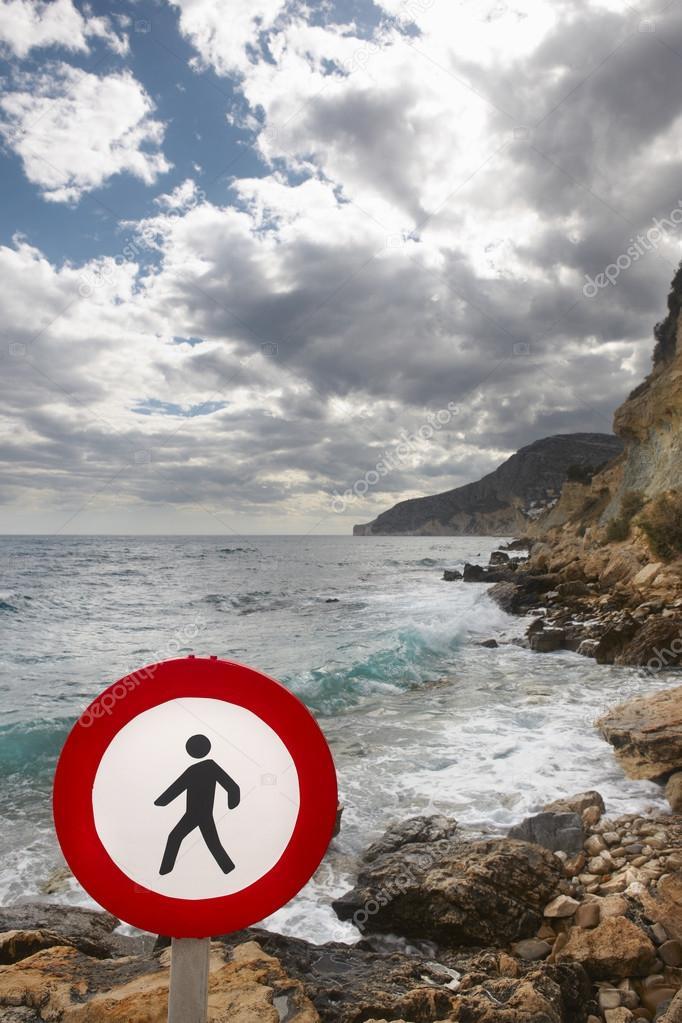 Pedestrian signal in a mediterranean coastine landscape. Alicant