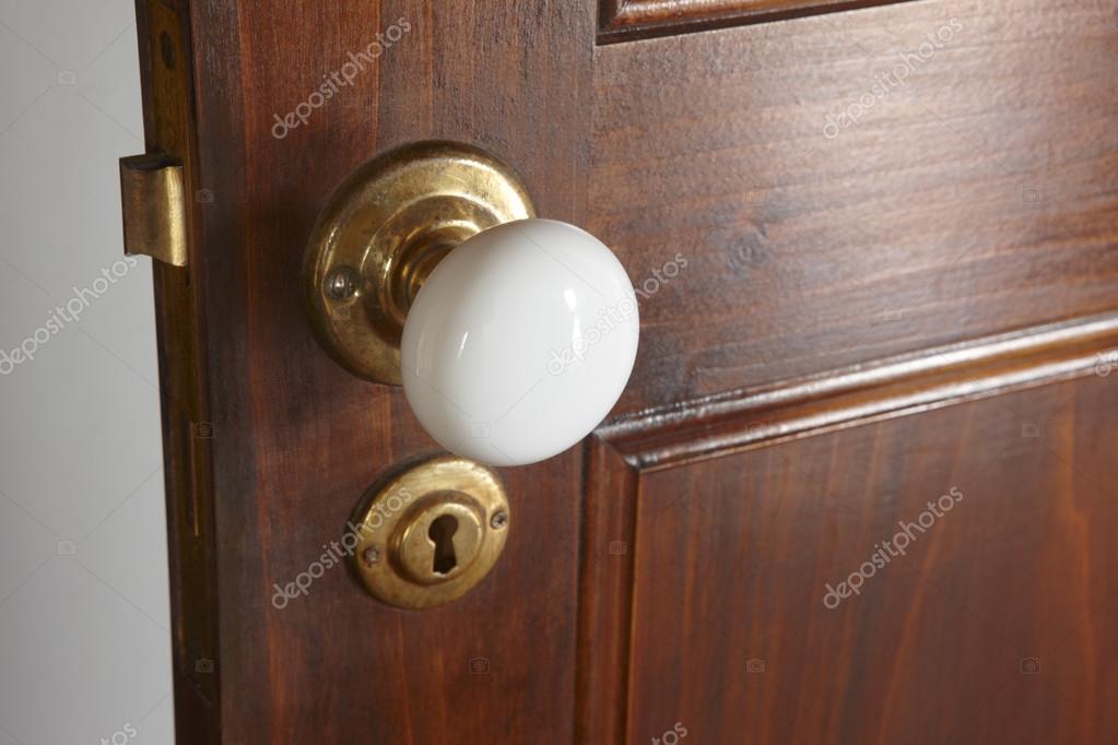 White door knob over a rustic traditional wooden door — Stock Photo ...