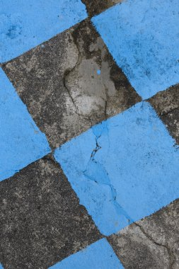 Antique stone floor painted in black and blue mosaic. Background