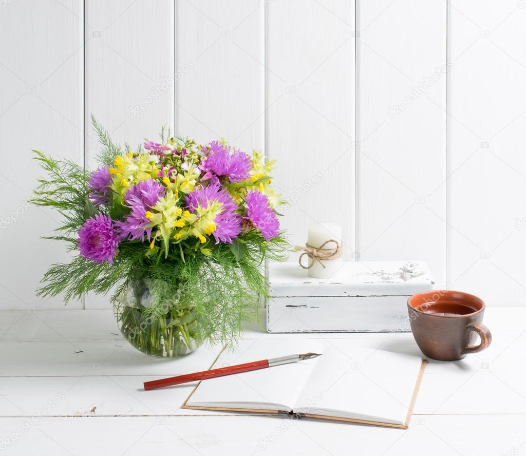 Flowers bouquet in vase with open diary and fountain pen — Stock ...