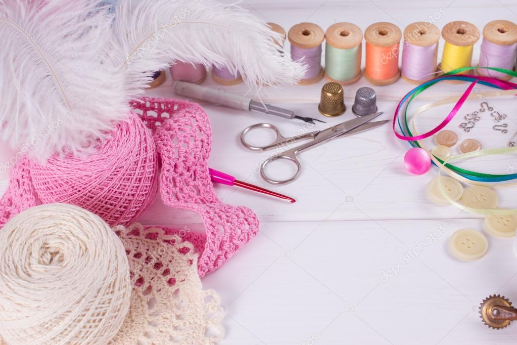 Set for sewing, knitting and needlework on a wooden board
