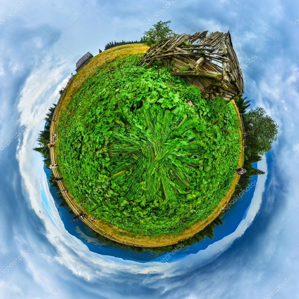 Green mountains field with old wooden house ruins planet