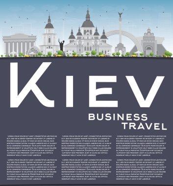 Kiev skyline with grey landmarks and blue sky.