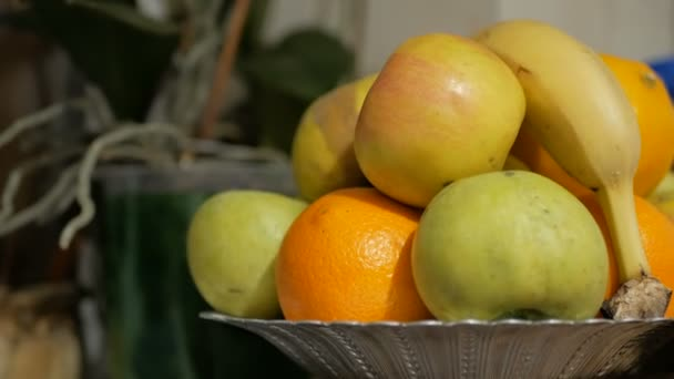 Apples, bananas and oranges are on a plate. Fresh juicy fruits are on a plate.