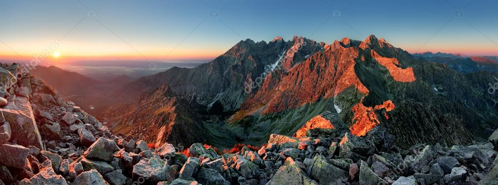 Mountain sunset panorama from peak