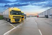 Fotografie Cargo truck at warehouse building