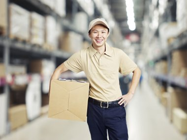 Portrait of a smiling young warehouse worker working in a cash and carry wholesale store. stock vector