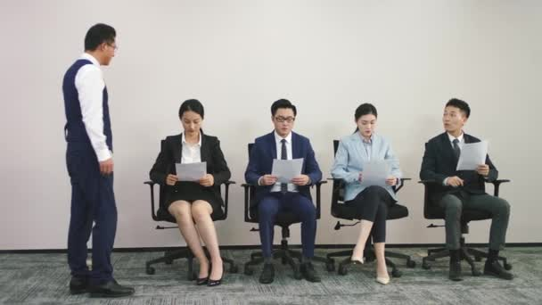 asian HR manager shaking hands and talking to female job applicant