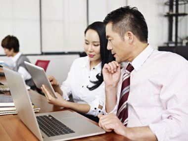 asian business man and woman working in office