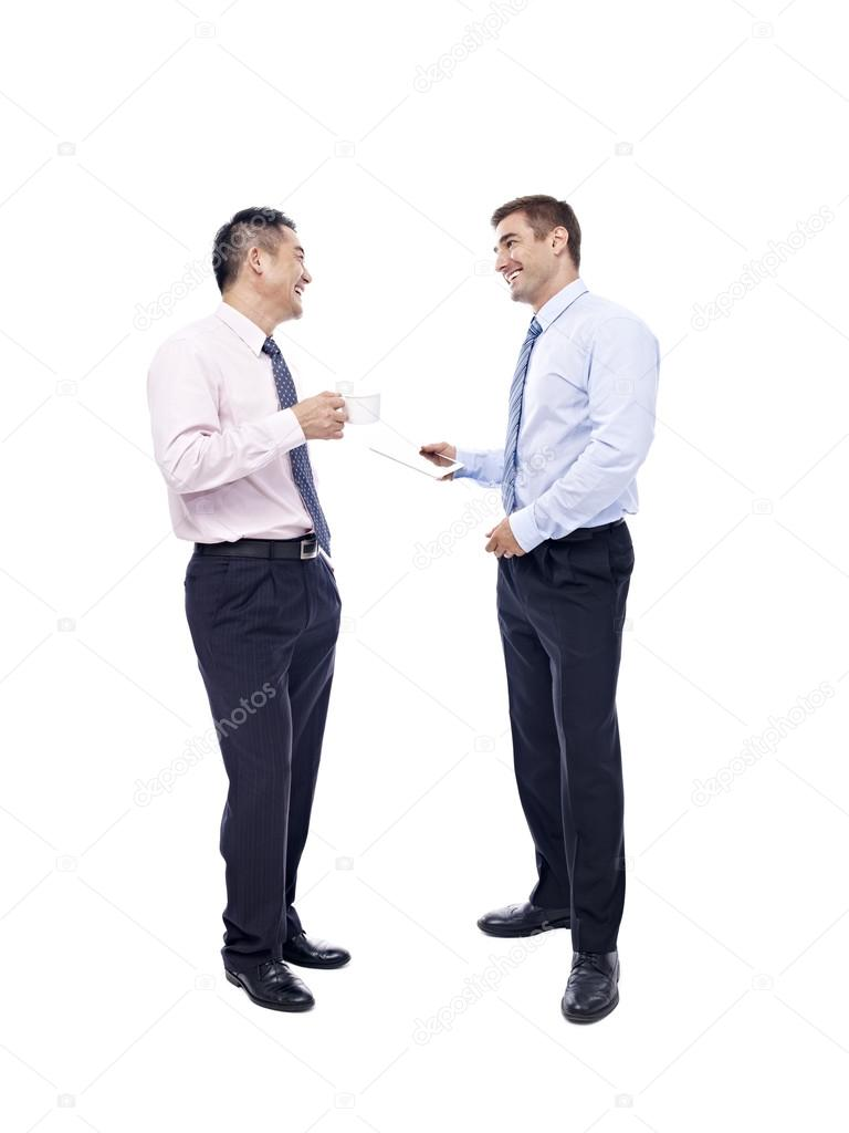 asian and caucasian businessmen having a  conversation