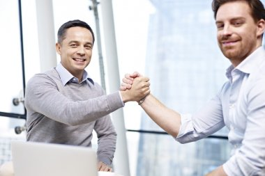 businesspeople holding hands